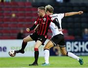 11 September 2021; Dean Byrne of Longford Town in action against Greg Sloggett of Dundalk during the SSE Airtricity League Premier Division match between Longford Town and Dundalk at Bishopsgate in Longford. Photo by Michael P Ryan/Sportsfile