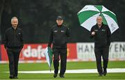 13 September 2021; Umpires, from left, Paul Reynolds, Mark Hawthorne and Alan Neill inspect the pitch before match three of the Dafanews International Cup ODI series between Ireland and Zimbabwe at Stormont in Belfast. Photo by Seb Daly/Sportsfile