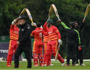13 September 2021; Brendan Taylor of Zimbabwe is given a guard of honour by team-mates as he makes his way onto the field of play for his last international match beforeduring match three of the Dafanews International Cup ODI series between Ireland and Zimbabwe at Stormont in Belfast. Photo by Seb Daly/Sportsfile