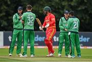 13 September 2021; Brendan Taylor of Zimbabwe is given a guard of honour by Ireland players as he makes his way onto the field of play for his last international match beforeduring match three of the Dafanews International Cup ODI series between Ireland and Zimbabwe at Stormont in Belfast. Photo by Seb Daly/Sportsfile