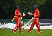 13 September 2021; Brendan Taylor of Zimbabwe, left, is greeted by team captain Craig Ervine after being bowled by Ireland's Josh Little in his last international match during match three of the Dafanews International Cup ODI series between Ireland and Zimbabwe at Stormont in Belfast. Photo by Seb Daly/Sportsfile