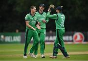 13 September 2021; Josh Little of Ireland, left, is congratulated by team-mates George Dockrell, centre, and wicketkeeper Lorcan Tucker after bowling Zimbabwe's Regis Chakabva during match three of the Dafanews International Cup ODI series between Ireland and Zimbabwe at Stormont in Belfast. Photo by Seb Daly/Sportsfile
