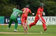 13 September 2021; Wessley Madhevere of Zimbabwe collides with Ireland's Josh Little, as team-mate Craig Ervine completes a single, during match three of the Dafanews International Cup ODI series between Ireland and Zimbabwe at Stormont in Belfast. Photo by Seb Daly/Sportsfile