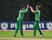 13 September 2021; Shane Getkate of Ireland, right, is congratulated by team-mate George Dockrell after claiming the wicket of Zimbabwe's Wessley Madhevere during match three of the Dafanews International Cup ODI series between Ireland and Zimbabwe at Stormont in Belfast. Photo by Seb Daly/Sportsfile