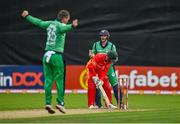 13 September 2021; Ireland wicketkeeper Lorcan Tucker celebrates after team-mate Andrew McBrine, left, bowled Zimbabwe's Sean Williams during match three of the Dafanews International Cup ODI series between Ireland and Zimbabwe at Stormont in Belfast. Photo by Seb Daly/Sportsfile