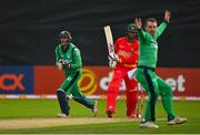 13 September 2021; Ireland wicketkeeper Lorcan Tucker celebrates catching Zimbabwe's Craig Ervine, off a delivery from team-mate Andrew McBrine, right, during match three of the Dafanews International Cup ODI series between Ireland and Zimbabwe at Stormont in Belfast. Photo by Seb Daly/Sportsfile
