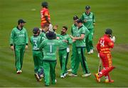 13 September 2021; Simi Singh of Ireland is congratulated by team-mates after bowling Zimbabwe's Ryan Burl during match three of the Dafanews International Cup ODI series between Ireland and Zimbabwe at Stormont in Belfast. Photo by Seb Daly/Sportsfile