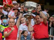 11 September 2021; Tyrone team doctor Michael Logan, left, and Tyrone joint-manager Feargal Logan celebrate with the Sam Maguire Cup following the GAA Football All-Ireland Senior Championship Final match between Mayo and Tyrone at Croke Park in Dublin. Photo by Stephen McCarthy/Sportsfile