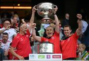 11 September 2021; Tyrone physiotherapist Louis O'Connor, Tyrone team doctor Damien O'Donnell and Tyrone physiotherapist Gareth Haughey celebrates with the Sam Maguire Cup following the GAA Football All-Ireland Senior Championship Final match between Mayo and Tyrone at Croke Park in Dublin. Photo by Stephen McCarthy/Sportsfile