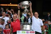 11 September 2021; Tyrone team doctor Michael Logan, left, and Tyrone physiotherapist Paul O'Neill celebrate with the Sam Maguire Cup following the GAA Football All-Ireland Senior Championship Final match between Mayo and Tyrone at Croke Park in Dublin. Photo by Stephen McCarthy/Sportsfile