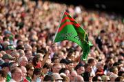 11 September 2021; A Mayo supporter waves her flag during the GAA Football All-Ireland Senior Championship Final match between Mayo and Tyrone at Croke Park in Dublin. Photo by Ray McManus/Sportsfile