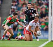 11 September 2021; Michael McKernan of Tyrone, under pressure from Conor Loftus of Mayo, prepares to clear during the GAA Football All-Ireland Senior Championship Final match between Mayo and Tyrone at Croke Park in Dublin. Photo by Ray McManus/Sportsfile