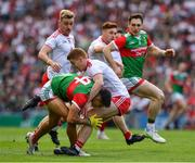 11 September 2021; Tommy Conroy of Mayo is stopped in his tracks by Peter Harte of Tyrone during the GAA Football All-Ireland Senior Championship Final match between Mayo and Tyrone at Croke Park in Dublin. Photo by Ray McManus/Sportsfile