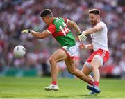 11 September 2021; Tommy Conroy of Mayo in action against Michael Plunkett of Mayo during the GAA Football All-Ireland Senior Championship Final match between Mayo and Tyrone at Croke Park in Dublin. Photo by Ray McManus/Sportsfile