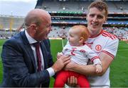 11 September 2021; Former Tyrone All Ireland winning captain Peter Canavan in conversation with his son in law Peter Harte of Tyrone and his 10 month old grandchild Ava after the GAA Football All-Ireland Senior Championship Final match between Mayo and Tyrone at Croke Park in Dublin. Photo by Ray McManus/Sportsfile