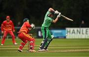 13 September 2021; Harry Tector of Ireland plays a shot to score the winning runs for his side during match three of the Dafanews International Cup ODI series between Ireland and Zimbabwe at Stormont in Belfast. Photo by Seb Daly/Sportsfile