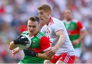 11 September 2021; Michael Plunkett of Mayo in action against Peter Harte of Tyrone during the GAA Football All-Ireland Senior Championship Final match between Mayo and Tyrone at Croke Park in Dublin. Photo by Piaras Ó Mídheach/Sportsfile