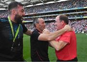11 September 2021; Tyrone joint-managers Feargal Logan, right, and Brian Dooher celebrate with selector Joe McMahon after their side's victory in the GAA Football All-Ireland Senior Championship Final match between Mayo and Tyrone at Croke Park in Dublin. Photo by Piaras Ó Mídheach/Sportsfile