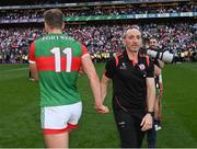 11 September 2021; Tyrone joint-manager Brian Dooher shakes hands with Mayo captain Aidan O'Shea after the GAA Football All-Ireland Senior Championship Final match between Mayo and Tyrone at Croke Park in Dublin. Photo by Piaras Ó Mídheach/Sportsfile