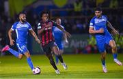 13 September 2021; Promise Omochere of Bohemians in action against Ethan Boyle, left, and Kosovar Sadiki of Finn Harps during the SSE Airtricity League Premier Division match between Finn Harps and Bohemians at Finn Park in Ballybofey, Donegal. Photo by Ramsey Cardy/Sportsfile