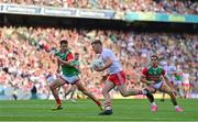 11 September 2021; Michael O'Neill of Tyrone in action against Enda Hession and Oisín Mullin of Mayo during the GAA Football All-Ireland Senior Championship Final match between Mayo and Tyrone at Croke Park in Dublin. Photo by Brendan Moran/Sportsfile
