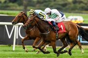 14 September 2021; Alizarine, with Chris Hayes up, on their way to winning the Irish Stallion Farms EBF Fillies Maiden, from second place Esculenta, with Ben Coen up, at Punchestown Racecourse in Kildare. Photo by Matt Browne/Sportsfile