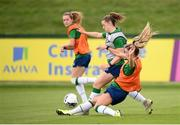 15 September 2021; Emily Whelan is tackled by Jamie Finn during a Republic of Ireland training session at the FAI National Training Centre in Abbotstown, Dublin. Photo by Stephen McCarthy/Sportsfile