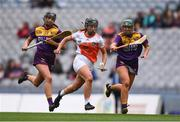12 September 2021; Ciara Donnelly of Armagh and Megan Cullen, left, and Roisin Cooney of Wexford during the All-Ireland Premier Junior Camogie Championship Final match between Armagh and Wexford at Croke Park in Dublin. Photo by Ben McShane/Sportsfile