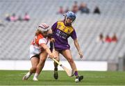 12 September 2021; Clodagh Jackman of Wexford and Eimear Smyth of Armagh during the All-Ireland Premier Junior Camogie Championship Final match between Armagh and Wexford at Croke Park in Dublin. Photo by Ben McShane/Sportsfile