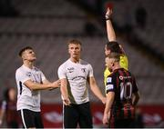 17 September 2021; Alex Kelly of Maynooth University Town, centre, is shown a red card from referee Adriano Reale during the extra.ie FAI Cup Quarter-Final match between Bohemians and Maynooth University Town at Dalymount Park in Dublin. Photo by Stephen McCarthy/Sportsfile