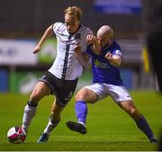 17 September 2021; Greg Sloggett of Dundalk in action against Mark Coyle of Finn Harps during the extra.ie FAI Cup Quarter-Final match between Finn Harps and Dundalk at Finn Park in Ballybofey, Donegal. Photo by Ramsey Cardy/Sportsfile
