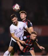 17 September 2021; Conor Delahunty of Maynooth University Town in action against Rory Feely and Keith Ward, right, of Bohemians during the extra.ie FAI Cup Quarter-Final match between Bohemians and Maynooth University Town at Dalymount Park in Dublin. Photo by Stephen McCarthy/Sportsfile