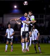 17 September 2021; Kosovar Sadiki of Finn Harps in action against Cameron Dummigan, below, and Andy Boyle of Dundalk during the extra.ie FAI Cup Quarter-Final match between Finn Harps and Dundalk at Finn Park in Ballybofey, Donegal. Photo by Ramsey Cardy/Sportsfile