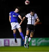 17 September 2021; Karl O'Sullivan of Finn Harps in action against Will Patching of Dundalk during the extra.ie FAI Cup Quarter-Final match between Finn Harps and Dundalk at Finn Park in Ballybofey, Donegal. Photo by Ramsey Cardy/Sportsfile
