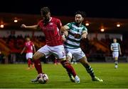 18 September 2021; Greg Bolger of Sligo Rovers in action against Richie Towell of Shamrock Rovers during the SSE Airtricity League Premier Division match between Sligo Rovers and Shamrock Rovers at The Showgrounds in Sligo. Photo by Stephen McCarthy/Sportsfile