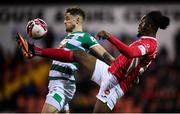 18 September 2021; Andre Wright of Sligo Rovers in action against Lee Grace of Shamrock Rovers during the SSE Airtricity League Premier Division match between Sligo Rovers and Shamrock Rovers at The Showgrounds in Sligo. Photo by Stephen McCarthy/Sportsfile