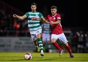 18 September 2021; Danny Mandroiu of Shamrock Rovers in action against Adam McDonnell of Sligo Rovers during the SSE Airtricity League Premier Division match between Sligo Rovers and Shamrock Rovers at The Showgrounds in Sligo. Photo by Stephen McCarthy/Sportsfile