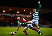 18 September 2021; Greg Bolger of Sligo Rovers in action against Dylan Watts of Shamrock Rovers during the SSE Airtricity League Premier Division match between Sligo Rovers and Shamrock Rovers at The Showgrounds in Sligo. Photo by Stephen McCarthy/Sportsfile