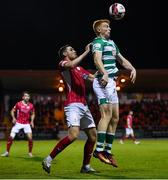 18 September 2021; Rory Gaffney of Shamrock Rovers in action against Garry Buckley of Sligo Rovers during the SSE Airtricity League Premier Division match between Sligo Rovers and Shamrock Rovers at The Showgrounds in Sligo. Photo by Stephen McCarthy/Sportsfile