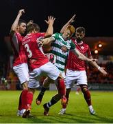 18 September 2021; Rory Gaffney of Shamrock Rovers in action against Sligo Rovers players, from left, Garry Buckley, Colm Horgan and Greg Bolger during the SSE Airtricity League Premier Division match between Sligo Rovers and Shamrock Rovers at The Showgrounds in Sligo. Photo by Stephen McCarthy/Sportsfile