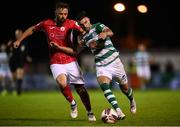 18 September 2021; Danny Mandroiu of Shamrock Rovers in action against Greg Bolger of Sligo Rovers during the SSE Airtricity League Premier Division match between Sligo Rovers and Shamrock Rovers at The Showgrounds in Sligo. Photo by Stephen McCarthy/Sportsfile
