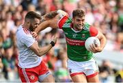11 September 2021; Aidan O'Shea of Mayo is tackled by Ronan McNamee of Tyrone during the GAA Football All-Ireland Senior Championship Final match between Mayo and Tyrone at Croke Park in Dublin. Photo by Ramsey Cardy/Sportsfile