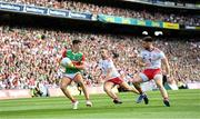 11 September 2021; Tommy Conroy of Mayo in action against Niall Sludden, left, and Pádraig Hampsey of Tyrone during the GAA Football All-Ireland Senior Championship Final match between Mayo and Tyrone at Croke Park in Dublin. Photo by Ramsey Cardy/Sportsfile