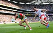 11 September 2021; Tommy Conroy of Mayo is tackled by Pádraig Hampsey of Tyrone during the GAA Football All-Ireland Senior Championship Final match between Mayo and Tyrone at Croke Park in Dublin. Photo by Ramsey Cardy/Sportsfile