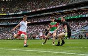 11 September 2021; Darragh Canavan of Tyrone shoots under pressure from Mayo players Lee Keegan and goalkeeper Rob Hennelly during the GAA Football All-Ireland Senior Championship Final match between Mayo and Tyrone at Croke Park in Dublin. Photo by Ramsey Cardy/Sportsfile