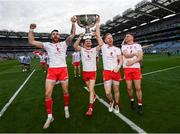11 September 2021; Tyrone players, from left, Ronan McNamee, Cathal McShane, Frank Burns and Niall Kelly with the Sam Maguire cup after the GAA Football All-Ireland Senior Championship Final match between Mayo and Tyrone at Croke Park in Dublin. Photo by Ramsey Cardy/Sportsfile