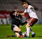 20 September 2021; Keith Ward of Bohemians is tackled by Ciaron Harkin of Derry City during the SSE Airtricity League Premier Division match between Bohemians and Derry City at Dalymount Park in Dublin. Photo by Seb Daly/Sportsfile