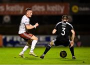 20 September 2021; Andy Lyons of Bohemians in action against Ciarán Coll of Derry City during the SSE Airtricity League Premier Division match between Bohemians and Derry City at Dalymount Park in Dublin. Photo by Seb Daly/Sportsfile