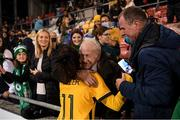 21 September 2021; Mary Fowler of Australia is greeted by her grandfather Kevin Fowler, from Ballymun, Dublin, following the women's international friendly match between Republic of Ireland and Australia at Tallaght Stadium in Dublin. Photo by Stephen McCarthy/Sportsfile
