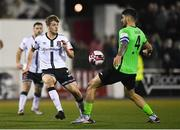 21 September 2021; Mark Hanratty of Dundalk in action against Kosovar Sadiki of Finn Harps during the extra.ie FAI Cup Quarter-Final Replay match between Dundalk and Finn Harps at Oriel Park in Dundalk, Louth. Photo by Ben McShane/Sportsfile